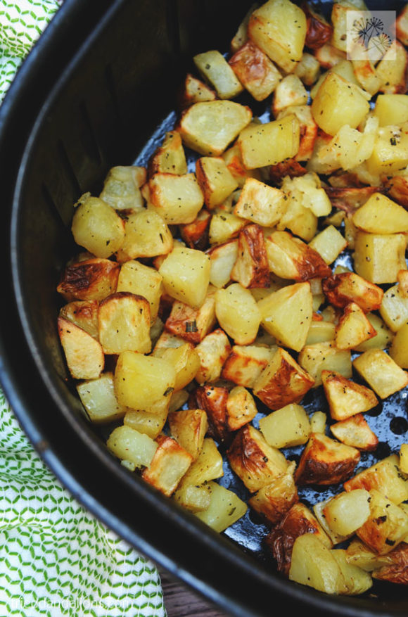 air fryer roasted potatoes in air fryer basket