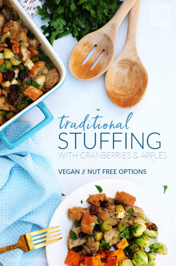 overhead view of plate of Traditional Vegan Stuffing, brussels sprouts, and squash, with blue napkin, white table, wooden spoons, and blue serving dish with text overlay