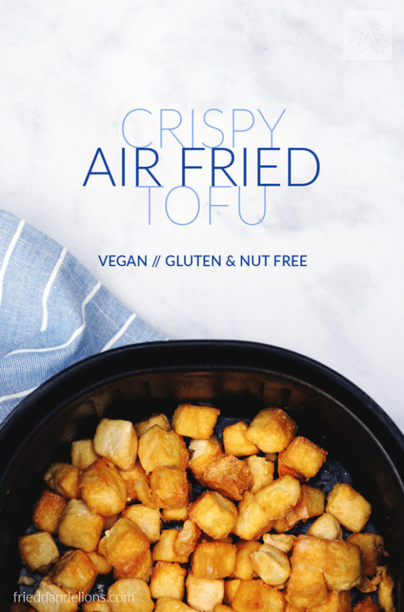 overhead shot of air fryer basked with crispy air fried tofu and text overlay