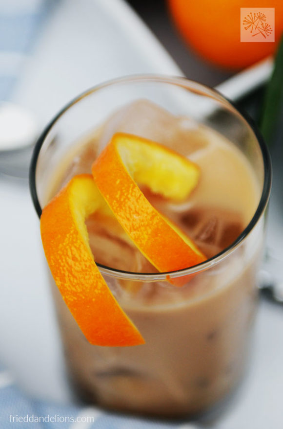 closeup of orange garnish on vegan white Russian