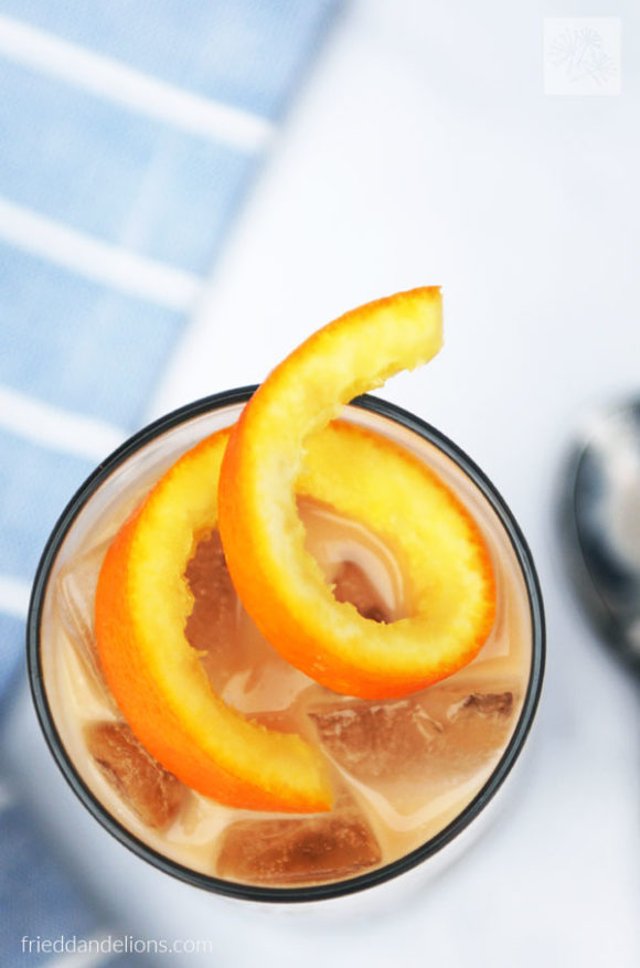 close up of orange garnish on vegan white Russian