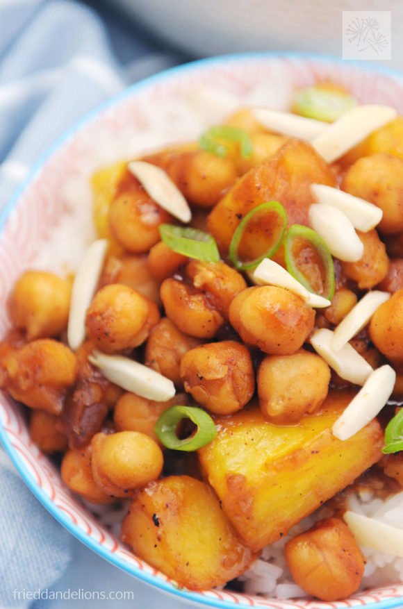 close up of chickpea stir fry with pineapples with slivered almond garnish