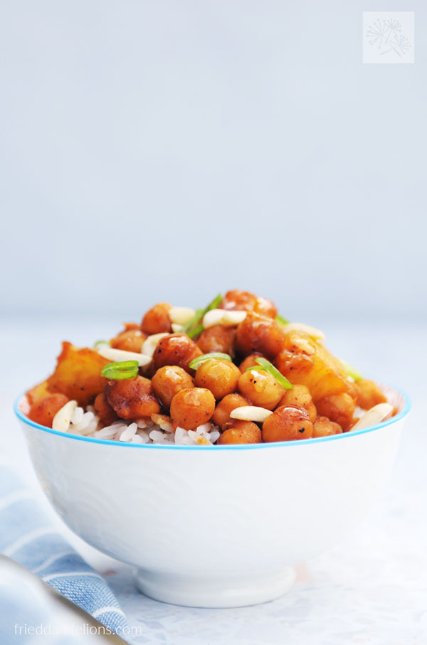 bowl of chickpea stir fry on top of Instant Pot Sushi Rice with blue napkin in background
