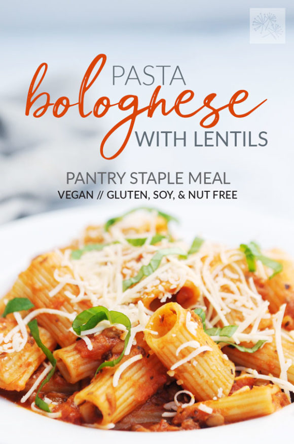 white bowl of vegan pasta bolognese with lentils with text overlay