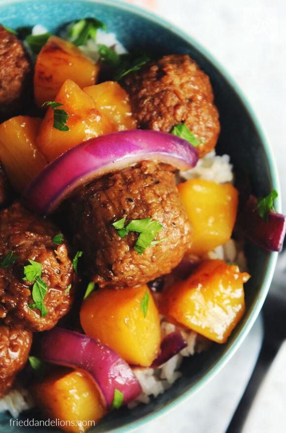 close up of vegan waikiki meatballs in blue bowl