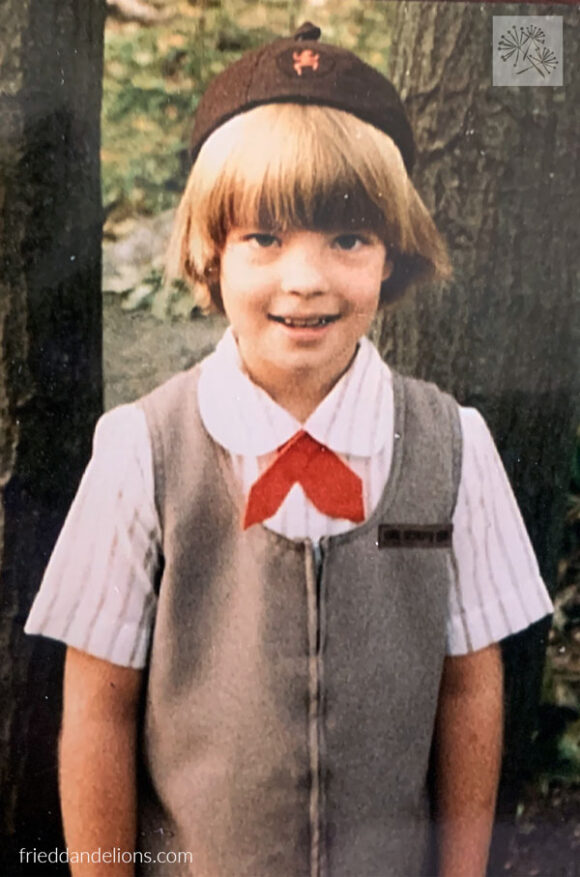 8 year old girl in Girl Scout uniform in the 80s