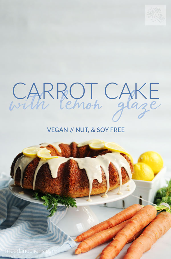 carrot cake with lemon glaze with text overlay, carrots in foreground, and lemons in the background