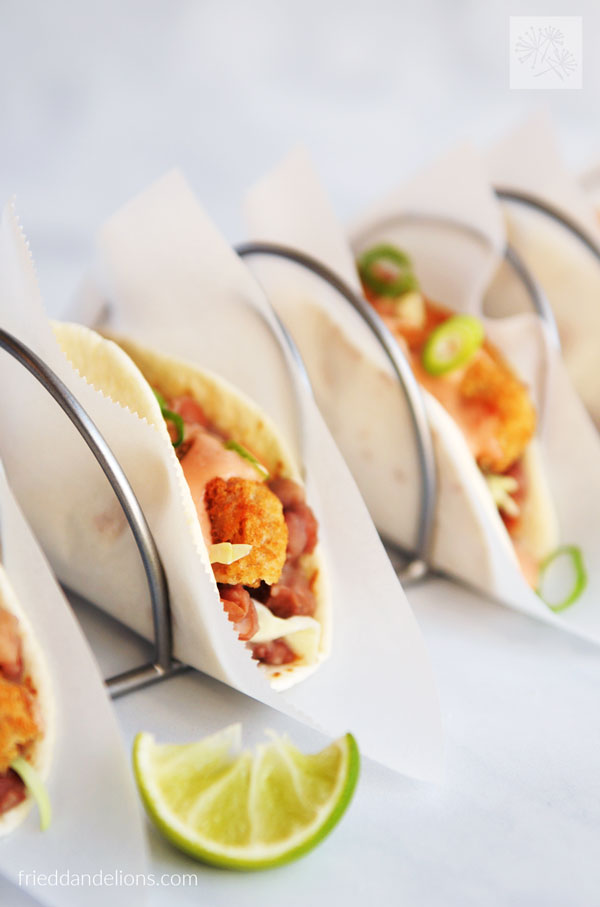 close up view of Vegan Crispy Chicken Tacos with lime wedge in foreground
